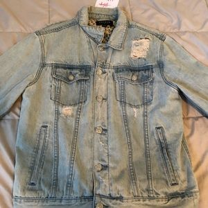 Button down denim jacket with leopard design under